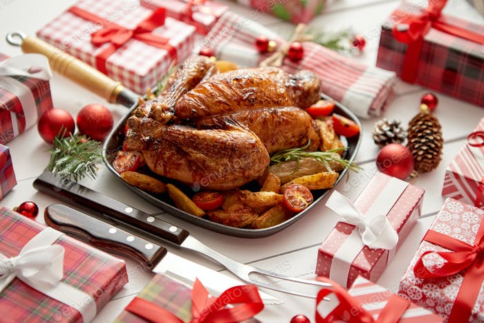 Roasted whole chicken or turkey served in iron pan with Christmas decoration