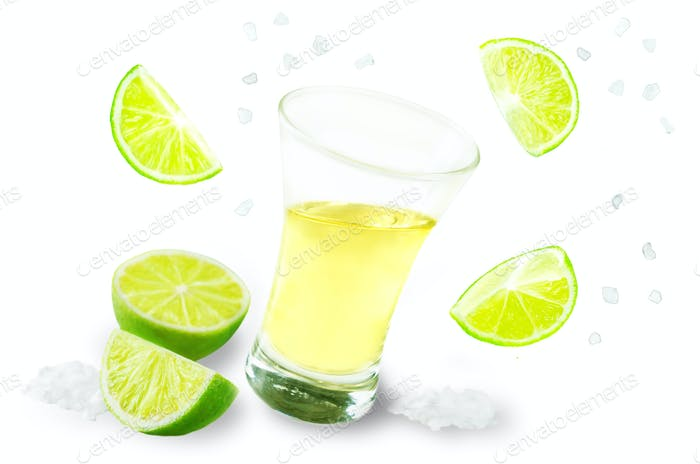 Glass of tequila liquor with falling salt and lime fruits isolat