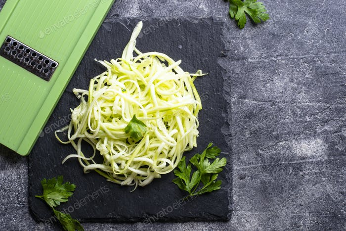 Raw green uncooked zucchini pasta