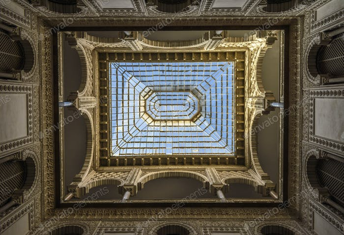 Interior low angle view of dome with skylight, Alcazar de Seville, Andalusia, Spain.