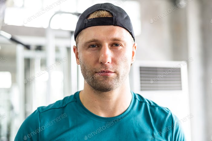 Portrait of athlete man in sportswear at gym