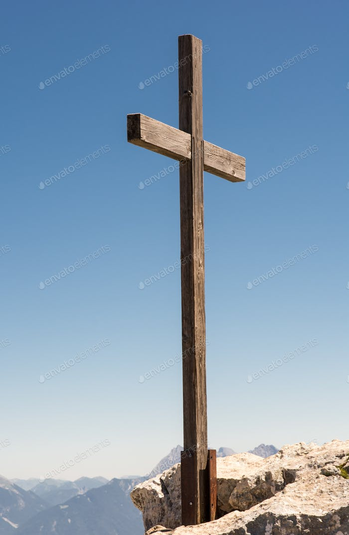 Wooden summit cross in the alps