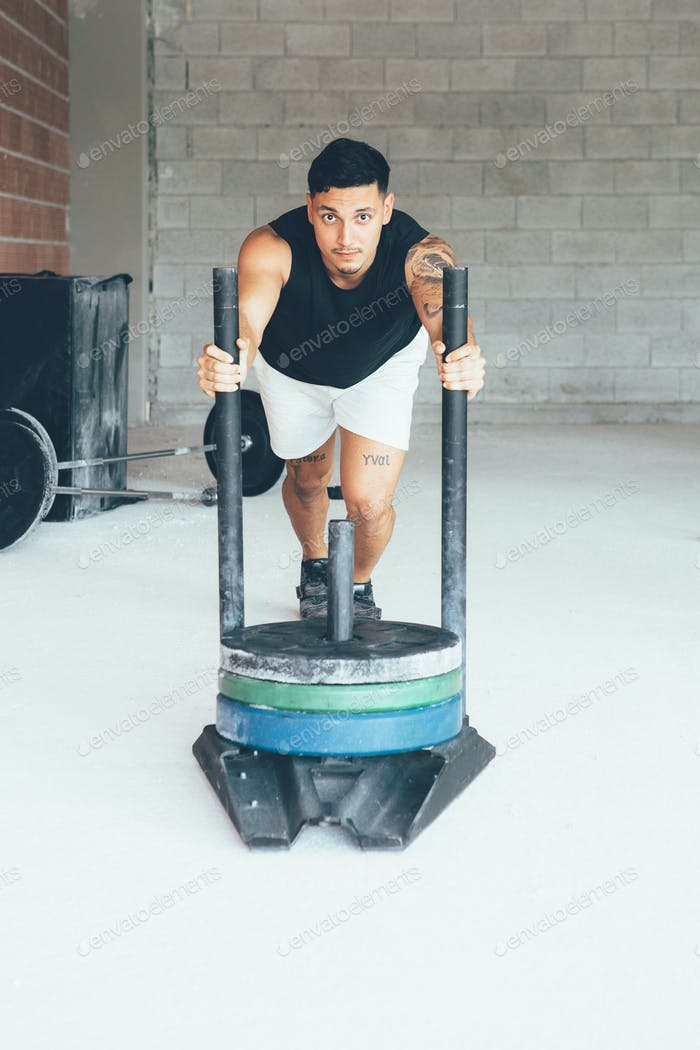 Fitness_young_man_doing_sled_pushing_exercise
