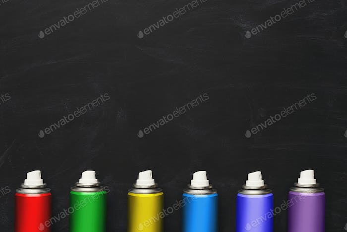 Spray cans nozzles on black background