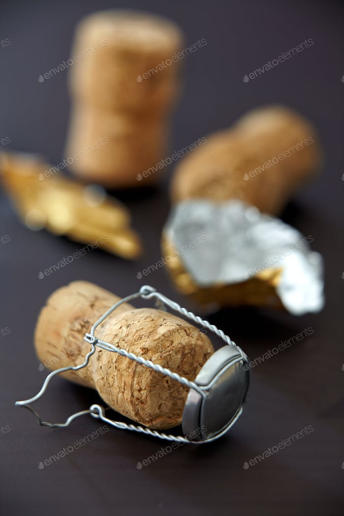 champagne corks on black background