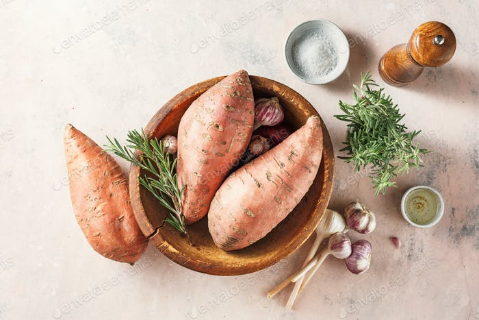 Organic sweet potatoes in a wooden bowl
