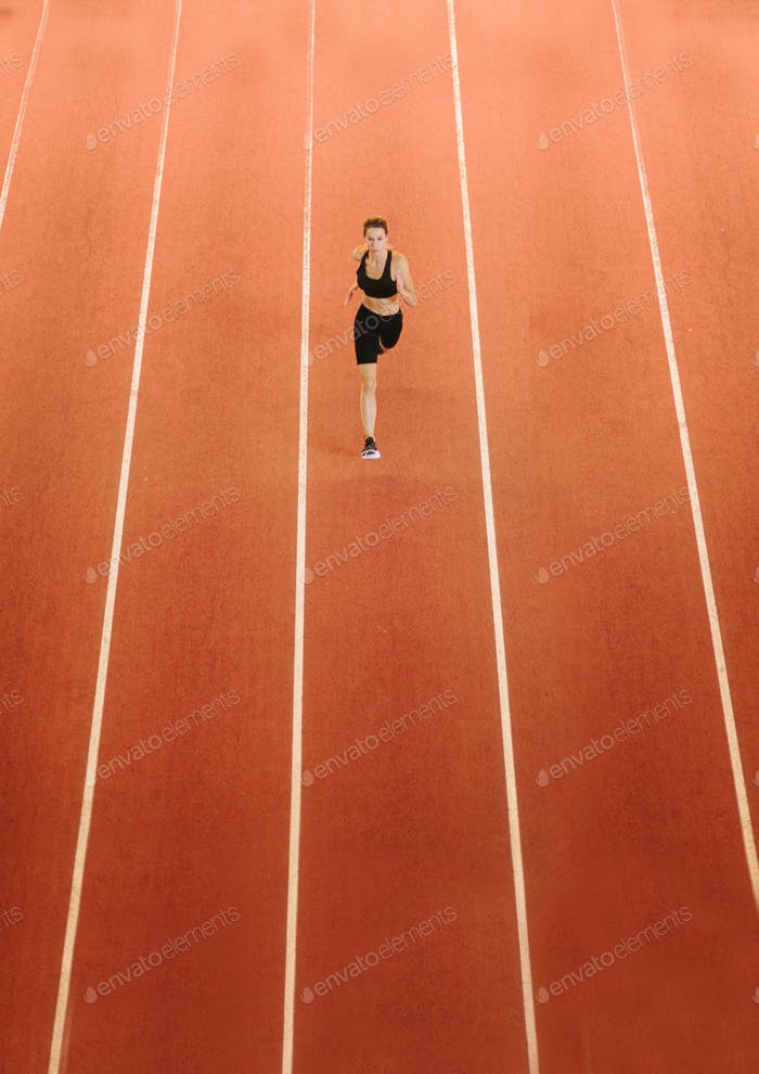 female runner on track in stadium