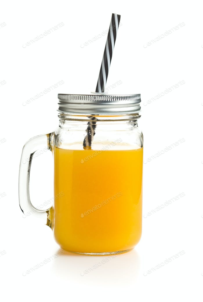 Fresh orange juice in glass jug.