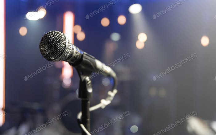 Close up microphone on blurred background with bokeh.
