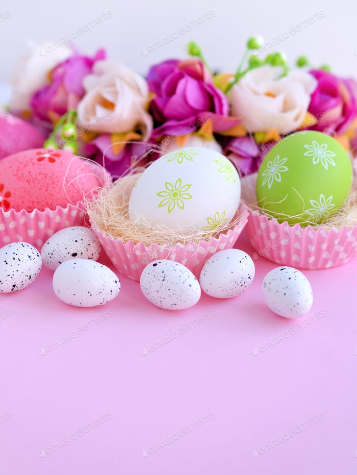 Easter eggs on a pink background. Festive background