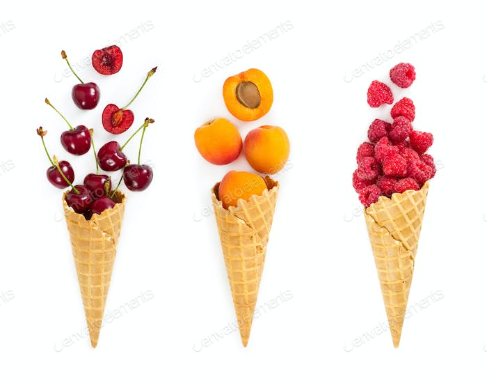 Set of assorted berries and fruit in waffle ice cream cone. Conc