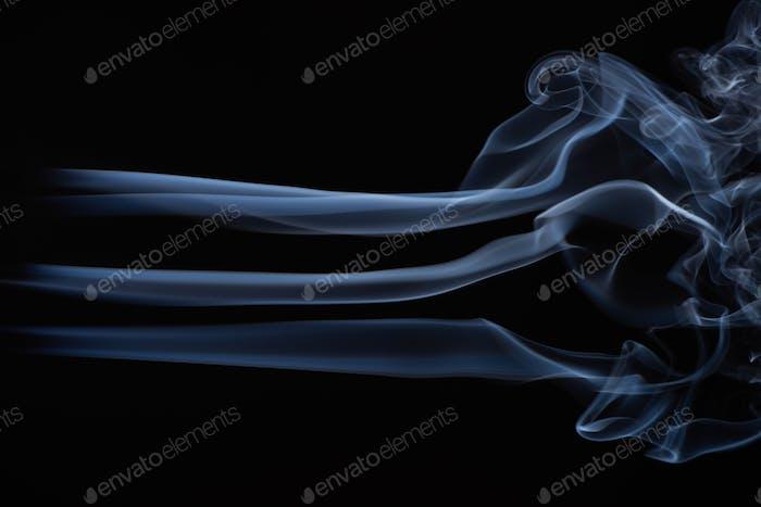 White Flowing Smoke Cloud on Black Background