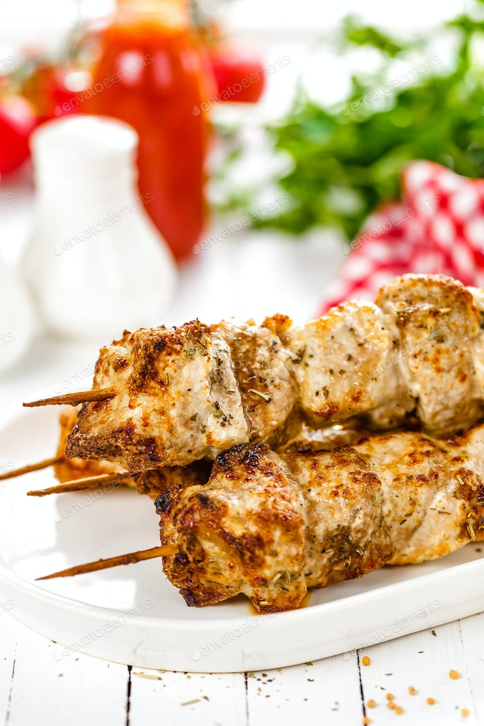 Grilled meat skewers, shish kebab on white background