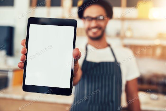Digital tablet in hand of cafe worker