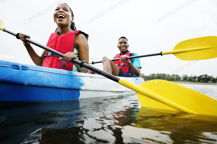 Couple canoeing in a lake