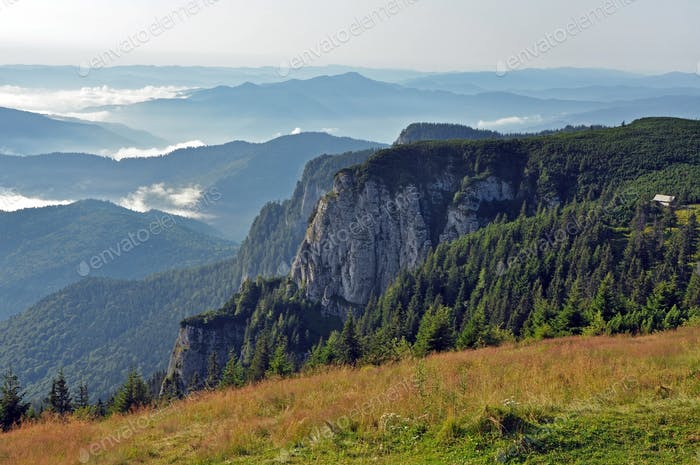 Morning mountain view with fog in the valley, Ceahlau mountains, Romania