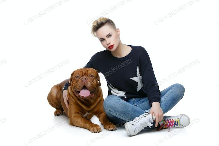 Girl with big brown dog