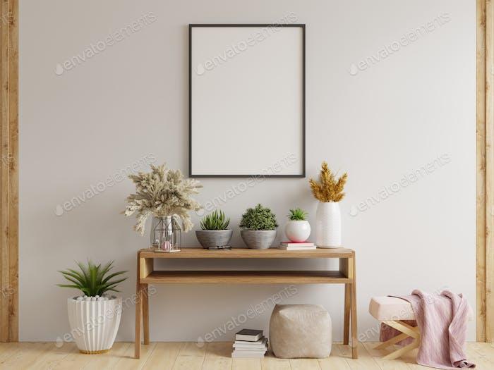 Marco de póster de maqueta en el armario en el interior.