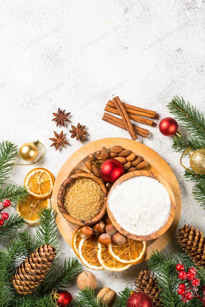 Christmas baking background with spices on white