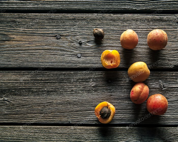 Fresh organic apricots on rustic wooden background. Fruit, food