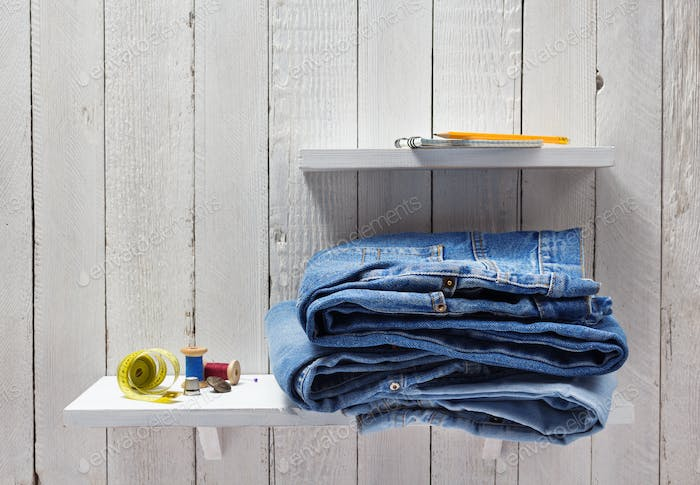 blue jeans on wooden shelf