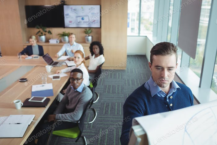Serious business entrepreneur explaining strategy to team at office