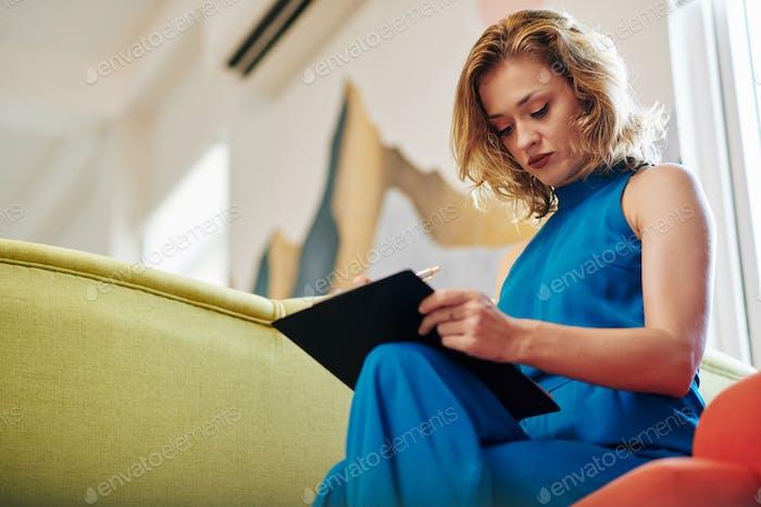 Woman correcting document