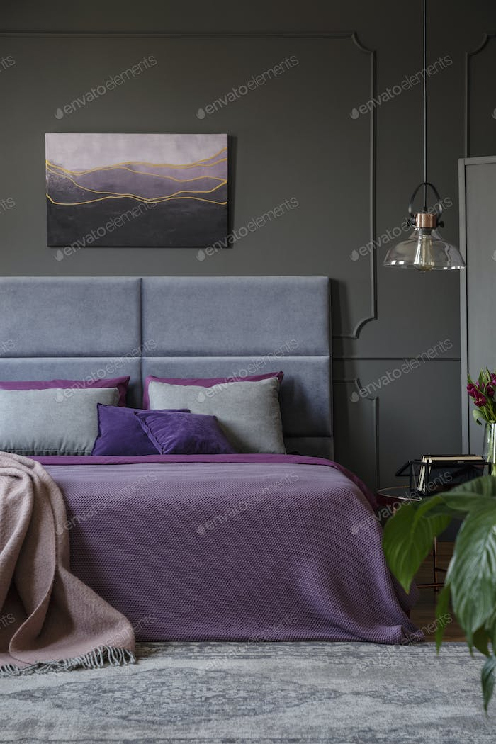 Poster in colorful bedroom interior