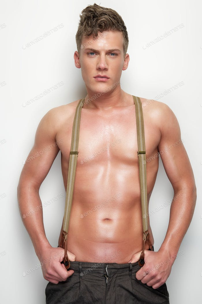 Handsome Man Undressed with Suspenders