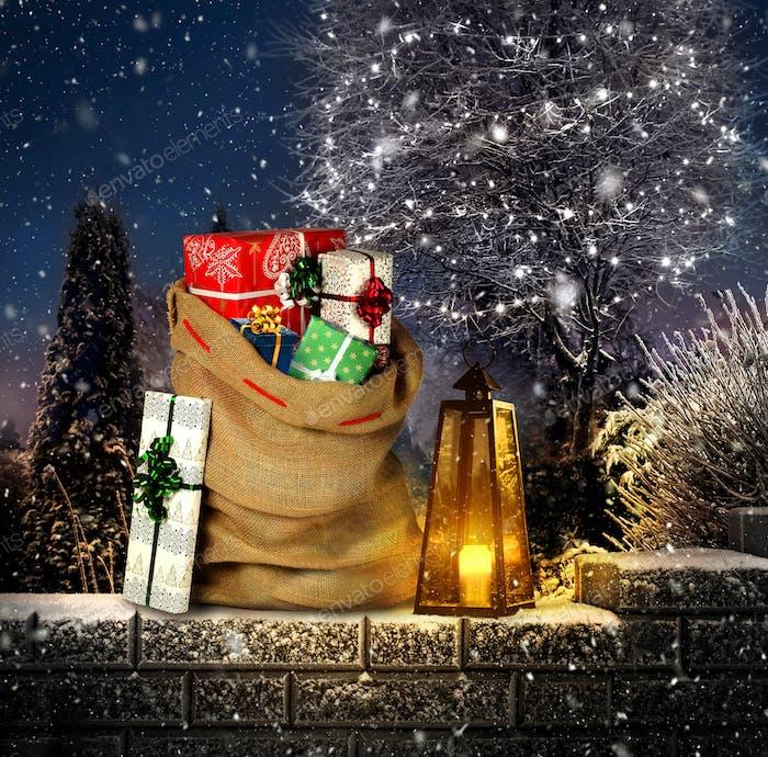 Santas present sack in winter garden