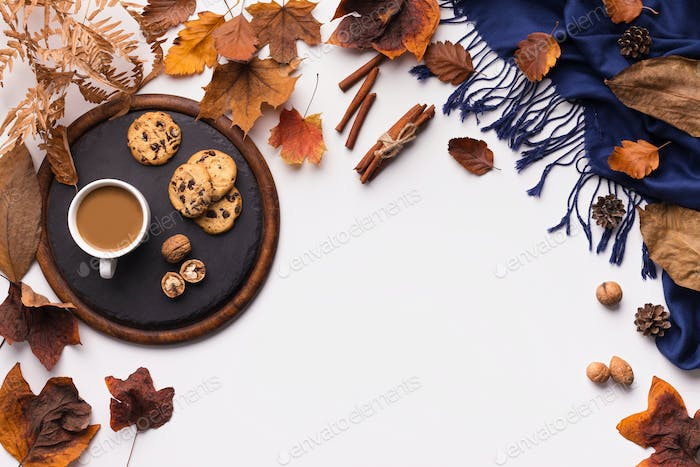 Autumn leaves pattern, coffee and blue warm scarf on white