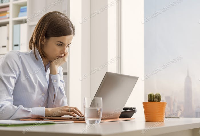 Business executive working with a laptop and connecting online