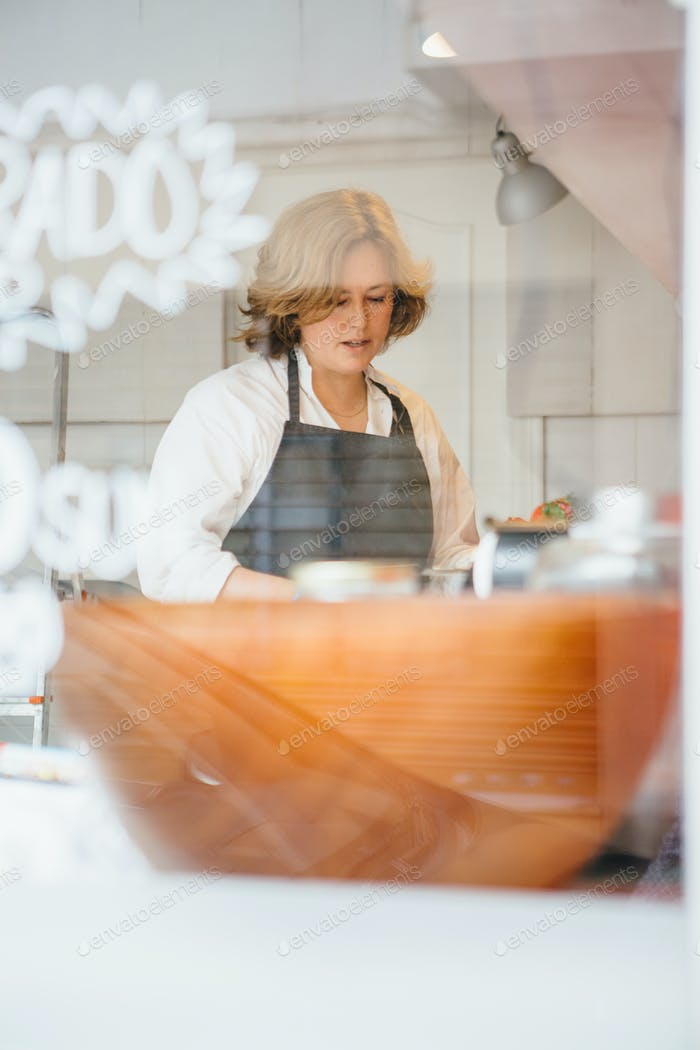 Adult confectioner in cafe