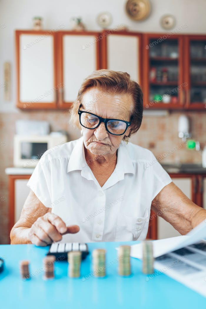 Senior woman checking her finances and investments