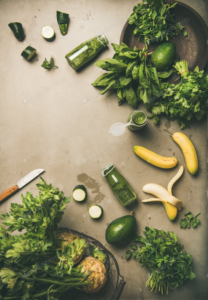 Ingredients for making green smoothie drink over concrete background