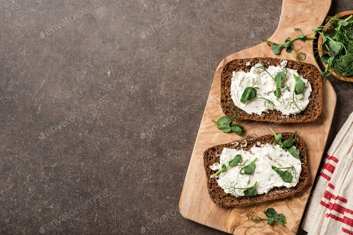 Rye bread with cheese cream and pea sprouts