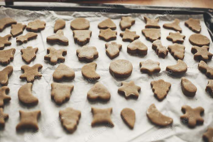 Christmas raw gingerbread cookies on baking tray