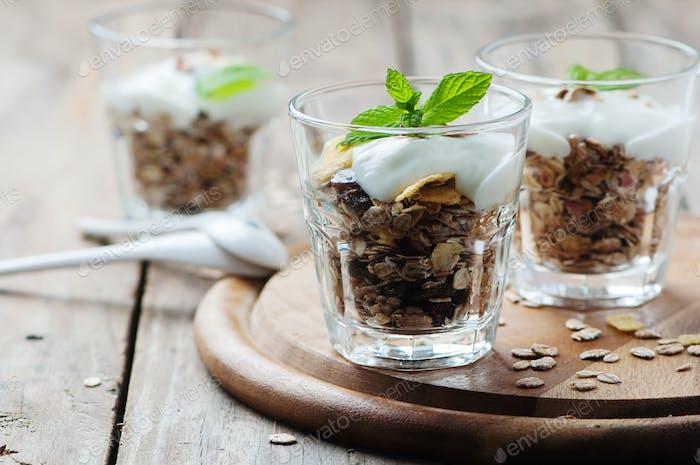 Healthy breakfast with muesli and yogurt