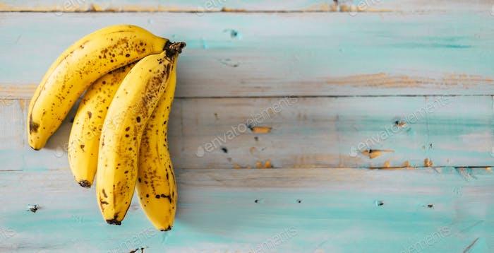 Fresh and tasty natural banana fruit on blue