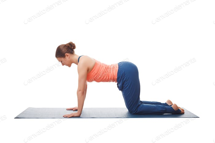 Beautiful sporty fit yogi girl practices yoga asana bitilasana