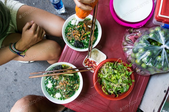 Eating Vietnamese soup with chicken balls