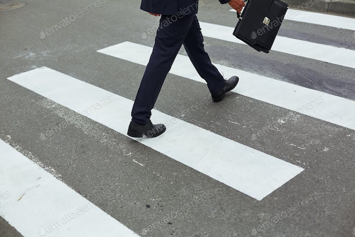 Businessman crossing road