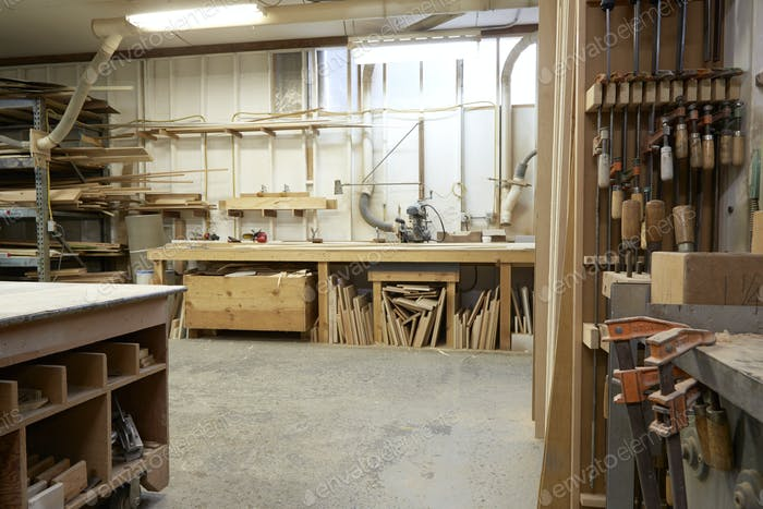Wood, workbenches and tools in workshop