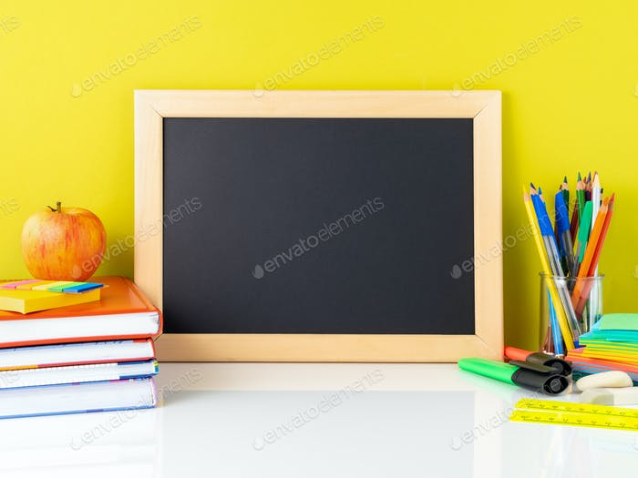 Chalkboard, apple and school supplies