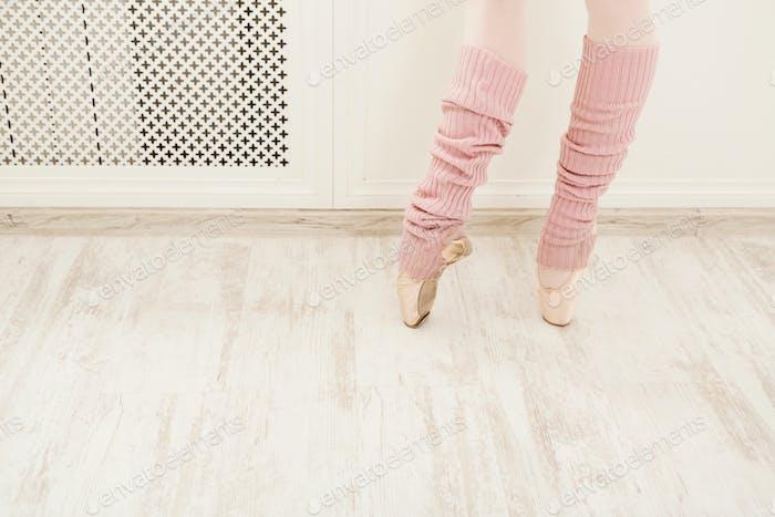 Legs of ballet dancer wearing gaiters closeup