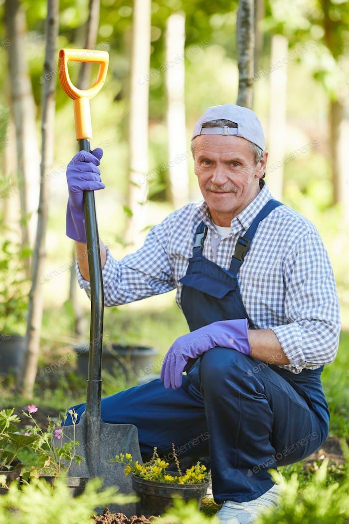 Smiling Man Working in Garden