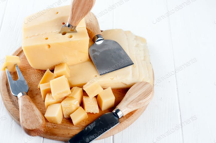 Various types of cheese on a plate