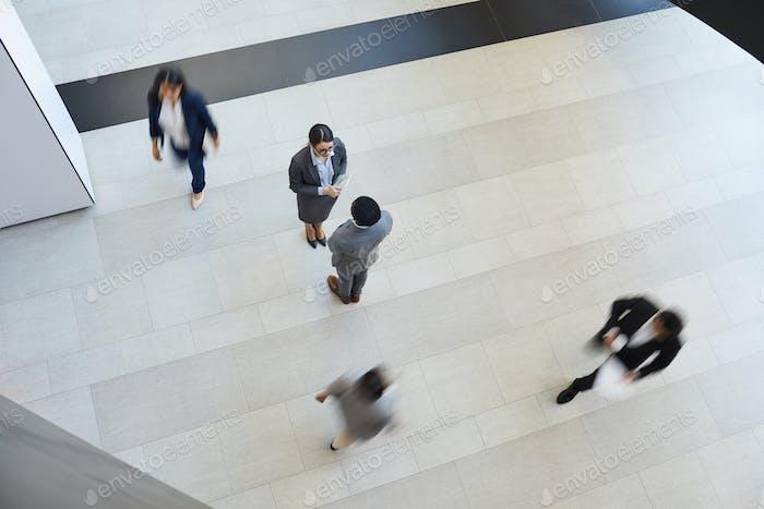 Business partners meeting in corridor