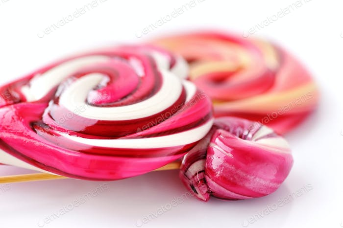 Colourful sweet lollipops on white background