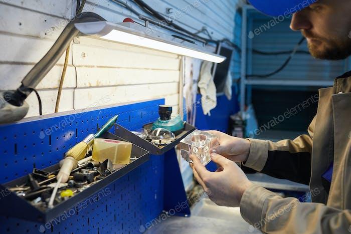 Caucasian Repairman At Work
